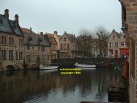 View from wharf off the Wollestraat along the canal southwards to the Rozenhoedkaai Bruges Belgium copyright free photo royalty free photo January 2007