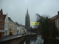 View along the Dijver towards the Church of Our Lady and Museum of Bruges (Onthaalkerk Onze Lieve Vrouw en Bruggemueum) Bruges Belgium copyright free photo royalty free photo January 2007
