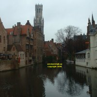 View from the Dijver northwards towards the Belfry of the Bruges museum (Bruggemuseum Belfort) Bruges Belgium copyright free photo royalty free photo January 2007