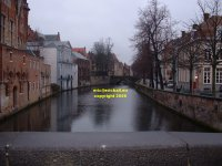 View from the Blinde ezelstraat  Donkey Street) bridge eastwards along the canal towards the Meestraat Bridge Bruges Belgium copyright free photo royalty free photo January 2007