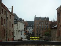 View from the Blinde ezelstraat (Blind Donkey Street) bridge westwards along the canal to the wharf off the Wollestraat Bruges Belgium copyright free photo royalty free photo January 2007