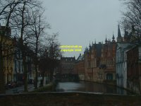 View along the canal westwards from the Meestraat Bridge towards the Blinde ezelstraat (Blind Donkey Street) bridge Bruges Belgium copyright free photo royalty free photo January 2007