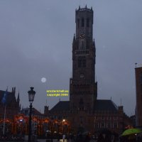 The belfry of the Bruges museum and City Hall (Bruggemuseum Belfort en Stadshall) viewed from the Markt Bruges Belgium copyright free photo royalty free photo January 2007