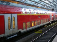 Double deck railway carriages Cologne Railway station Köln Koeln Germany Deutschland copyright free photo royalty free photo