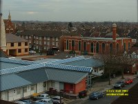 view of industry and religion  wind turbinesIlford London Essex copyright free photo royalty free photo